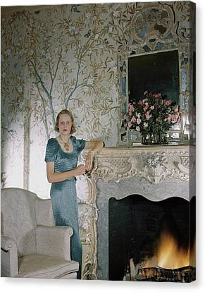 Laura Elizabeth Curtis By A Fireplace Canvas Print by Horst P. Horst