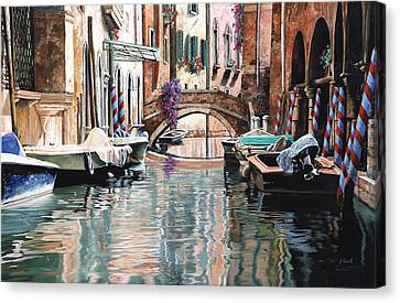 Le Barche E I Pali Colorati Canvas Print by Guido Borelli