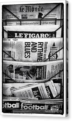 Le Monde Canvas Print by John Rizzuto