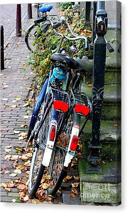Leaning Bicycles Canvas Print by Julia Willard
