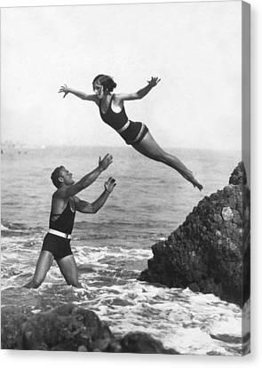 Swim Suit Canvas Print - Leap Into Life Guard's Arms by Underwood Archives