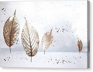 Leaves In Snow Canvas Print by Carol Leigh