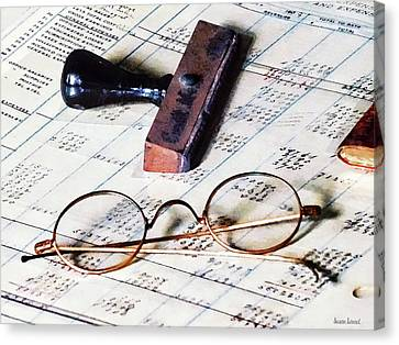 Ledger With Eyeglasses And Rubber Stamp Canvas Print