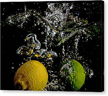 Canvas Print featuring the digital art Lemon And Lime Splash by John Hoey
