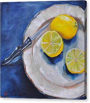 Lemons On A Plate Canvas Print by Lindsay Frost