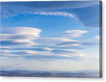Lenticular Clouds Forming In The Troposphere Canvas Print