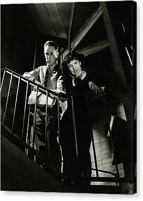 Man Looking Down Canvas Print - Leslie Howard And Peggy Conklin Leaning by Lusha Nelson