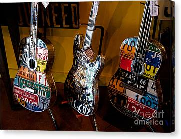 Canvas Print featuring the photograph License Plate Guitars by Vinnie Oakes