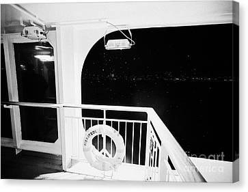 lifebelt on board the hurtigruten ship ms midnatsol at night in winter in Tromso troms Norway Canvas Print by Joe Fox