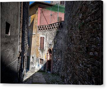 Canvas Print featuring the photograph Light At The End Of The Alley by Uri Baruch