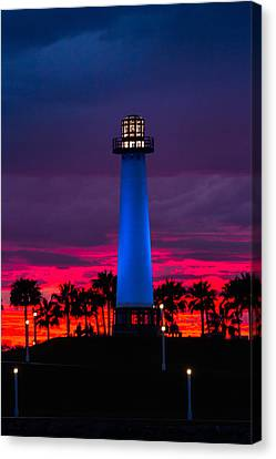 Light House In The Firey Sky Canvas Print by Denise Dube