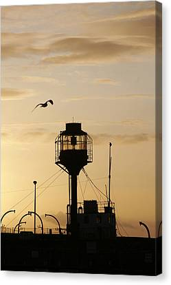 Light Ship Silhouette At Sunset Canvas Print