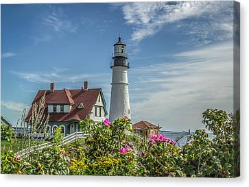 Lighthouse And Wild Roses Canvas Print