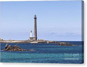 Lighthouse At Ile Vierge Brittany France Canvas Print by Colin and Linda McKie