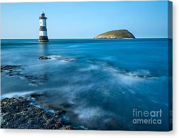 Lighthouse At Penmon Point Canvas Print by Adrian Evans
