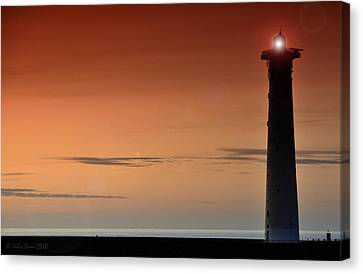Canvas Print featuring the photograph Lighthouse At Sunrise by Julis Simo