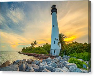 Lighthouse At Sunset Canvas Print by George Kenhan