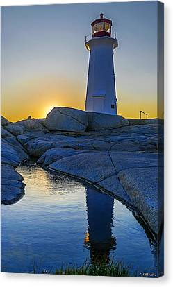 Lighthouse At Sunset Canvas Print by Ken Morris