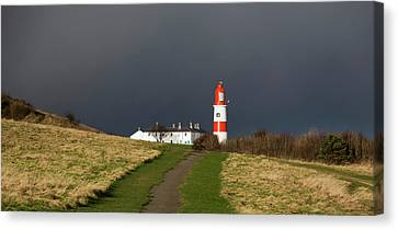 Lighthouse At The End Of A Path Canvas Print by John Short