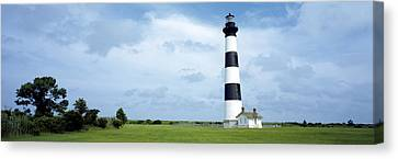 Lighthouse In A Field, Bodie Island Canvas Print by Panoramic Images