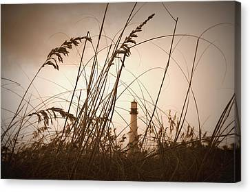 Lighthouse In The Distance Inn Sepia Canvas Print by Laurie Perry