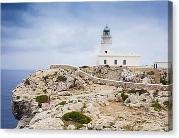 Lighthouse Of Caballeria Canvas Print by Antonio Macias Marin