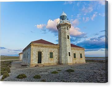 Lighthouse Of Punta Nati Canvas Print by Antonio Macias Marin