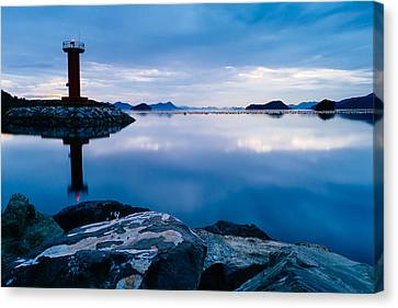 Lighthouse On Blue Canvas Print by Roy Cruz