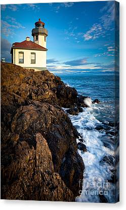 Lighthouse On Bluff Canvas Print by Inge Johnsson