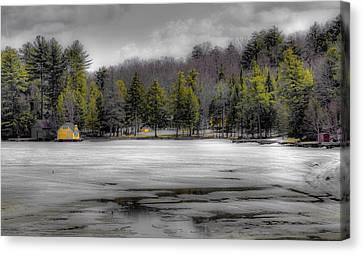 Lighthouse On Frozen Pond Canvas Print by David Patterson