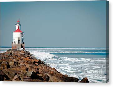 Lighthouse On Stone And Ice Canvas Print