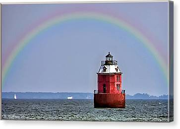 Lighthouse On The Bay Canvas Print