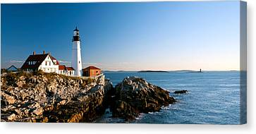 Lighthouse On The Coast, Portland Head Canvas Print by Panoramic Images