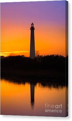 Lighthouse Silhouette Canvas Print by Michael Ver Sprill