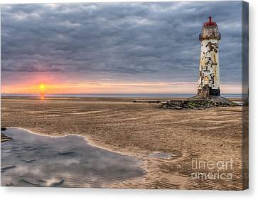 Lighthouse Sunset Canvas Print by Adrian Evans