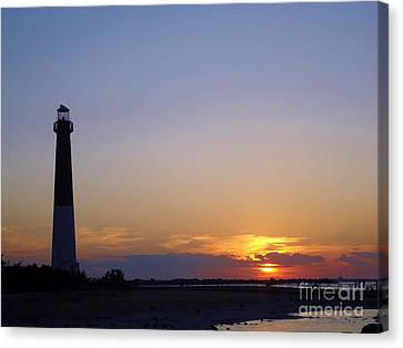 Lighthouse Sunset Canvas Print by Art Dingo
