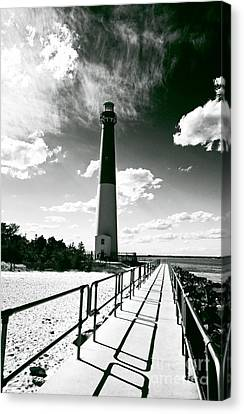 Lighthouse Walk Canvas Print by John Rizzuto