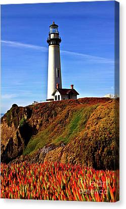 Canvas Print featuring the photograph Lighthouse With Red Blooms by Charles Lupica