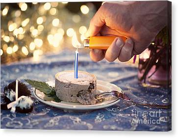 Lighting The Birthday Candle Canvas Print by Juli Scalzi