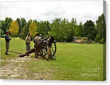 Lighting The Fuse Of A Civil War Canon Canvas Print by Bob Sample