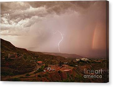 Lightning And A Rainbow Canvas Print by Ron Chilston