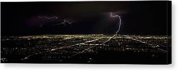Lightning In The Sky Over A City Canvas Print