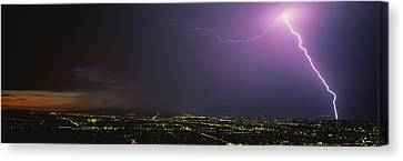 Lightning Storm At Night Canvas Print by Panoramic Images