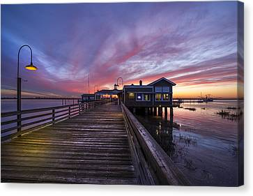 Lights On The Dock Canvas Print by Debra and Dave Vanderlaan
