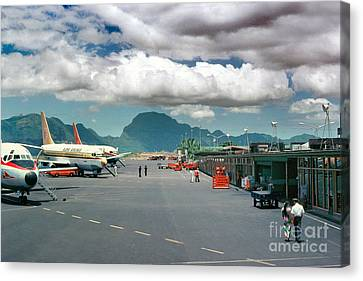 Lihue Airport With Cumulus Clouds In Kauai Hawaii  Canvas Print by Wernher Krutein