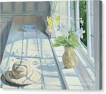 Lilies And A Straw Hat Canvas Print by Timothy Easton
