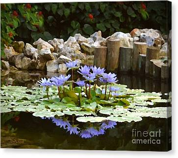 Lilies On The Pond Canvas Print by Darla Wood