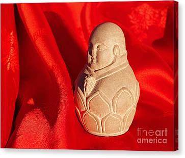 Limestone Buddha On Red Silk Canvas Print by Anna Lisa Yoder