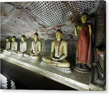 Golden Temple Canvas Print - Line Of Buddha Statues In Cave II by Panoramic Images