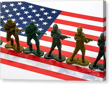 Line Of Toy Soldiers On American Flag Crisp Depth Of Field Canvas Print by Amy Cicconi